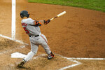 Baltimore Orioles' Anthony Santander follows through after hitting a three-run double off Philadelphia Phillies pitcher Jake Arrieta during the fifth inning of a baseball game, Thursday, Aug. 13, 2020, in Philadelphia. (AP Photo/Matt Slocum)