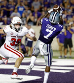 Kansas State wide receiver Isaiah Zuber (7) gets by South Dakota linebacker Jack Cochrane (39) to catch a pass in the end zone to score a touchdown during the second half of an NCAA college football game Saturday, Sept. 1, 2018, in Manhattan, Kan. Kansas State won 27-24. (AP Photo/Charlie Riedel)