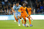 Houston Dynamo midfielder Fafa Picault (10) controls the ball in front of Minnesota United defender Michael Boxall (15) during the first half of an MLS soccer match Saturday, Sept. 25, 2021, in St. Paul, Minn. (AP Photo/Andy Clayton-King)
