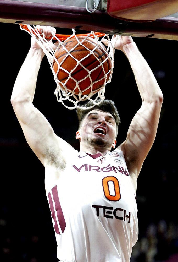 Virginia Tech's Hunter Cattoor dunks in the first half of an NCAA college basketball game against Longwood in Blacksburg, Va., Monday, Dec. 21, 2020. (Matt Gentry/The Roanoke Times via AP, Pool)