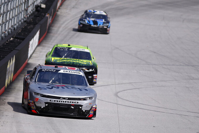 Driver Noah Gragson (9) leads Vinnie Miller down the back stretch during practice for an NASCAR Xfinity Series auto race on Thursday, Aug. 15, 2019, in Bristol, Tenn. (AP Photo/Wade Payne)