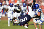 Auburn wide receiver Kobe Hudson (5) flips in the air as he is tackled by Georgia State linebacker Jordan Veneziale (40) during the first half of an NCAA football game Saturday, Sept. 25, 2021, in Auburn, Ala. (AP Photo/Butch Dill)