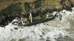 Undated image released Monday Feb. 17, 2020, by Irish Coast Guard showing the abandoned cargo ship MV Alta, that has washed up on the coast of County Cork, near Ballycotton, southern Ireland.  The MV Alta is believed to have had 10 crew members aboard who were rescued by the US Coast Guard.  Since September 2018, the ship has been drifting with no crew aboard, and it was last seen off the coast of West Africa before being washed up in southern Ireland during Storm Dennis. (Irish Coast Guard via AP)