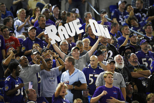 FILE - In this Sept. 11, 2014, file photo, football fans cheer during the first half of an NFL football game between the Pittsburgh Steelers and the Baltimore Ravens in Baltimore. At a time when America is trying to cope with the financial fallout created by the deadly coronavirus, the renewal of NFL season tickets is not exactly a high priority in the midst of soaring unemployment, business closures and a volatile stock market. Most teams understand this, and have acted accordingly. (AP Photo/Nick Wass, File)