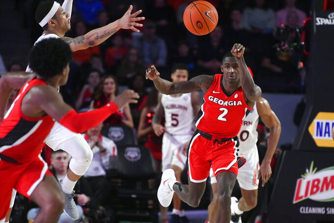 Georgia guard Jordan Harris (2) passes the ball downcourt during the second half of the team's NCAA college basketball game against Auburn, Wednesday, Feb. 19, 2020, in Athens, Ga. Georgia won 65-55. (AP Photo/John Amis)