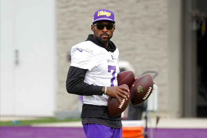 Minnesota Vikings' Patrick Peterson, entering his 11th season in the NFL and his first with the Vikings watches during NFL football training camp, Thursday, Aug. 5, 2021, in Eagan, Minn. Peterson took advantage of a new rule to make the switch to his long-favored No. 7, with cornerbacks now allowed to wear any number from 1 to 49. Several of Peterson's peers around the league have done the same, many of them cornerbacks. (AP Photo/Jim Mone)
