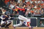 Washington Nationals' Juan Soto hits a double during the third inning of Game 2 of the baseball World Series against the Houston Astros Wednesday, Oct. 23, 2019, in Houston. (AP Photo/David J. Phillip)