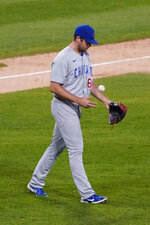Chicago Cubs relief pitcher Jason Adam tosses a ball after Chicago White Sox's Yoan Moncada hit a two-run home run during the sixth inning of a baseball game in Chicago, Saturday, Sept. 26, 2020. (AP Photo/Nam Y. Huh)