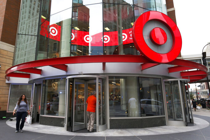 FILE - In this July 10, 2019, file photo shoppers visit the downtown Target store in Minneapolis. Target has reported surging sales and profits for its fiscal first quarter thanks to shoppers who bought more apparel as they emerge from the pandemic.  (AP Photo/Jim Mone, File)