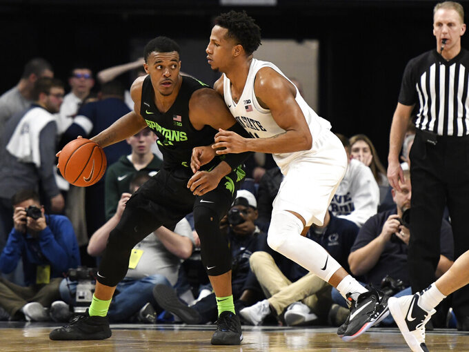 Michigan State's Xavier Tillman, left, works against Penn State's Lamar Stevens during the second half of an NCAA college basketball game, Tuesday, March 3, 2020, in State College, Pa. (AP Photo/John Beale)