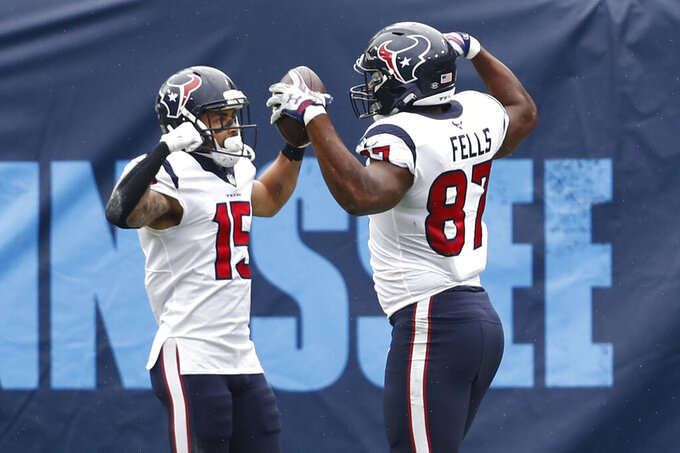 Houston Texans tight end Darren Fells (87) celebrates with wide receiver Will Fuller (15) after Fells caught a touchdown pass against the Tennessee Titans in the first half of an NFL football game Sunday, Oct. 18, 2020, in Nashville, Tenn. (AP Photo/Wade Payne)