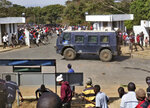 Protesters pelt stones at a riot police armoured vehicle inside the Capital Hill premises in Lilongwe, Thursday June 20, 2019. Demonstrators took to the streets over last month's disputed elections which saw President Peter Mutharika narrowly win a second term. (AP Photo)