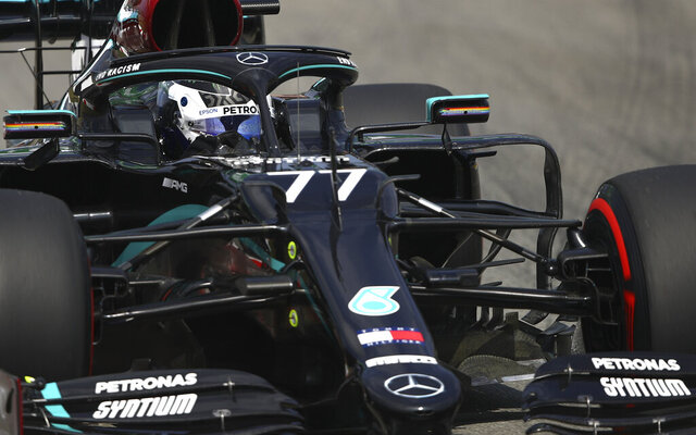 Mercedes driver Valtteri Bottas of Finland steers his car during a practice session prior to the Formula One Grand Prix at the Barcelona Catalunya racetrack in Montmelo, Spain, Friday, Aug. 14, 2020. (Bryn Lennon, Pool via AP)