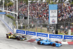 IndyCar series points leader Alex Palou (10) takes Turn 1 with Colton Herta (26) during an auto race at Grand Prix of Long Beach, Sunday, Sept. 26, 2021, in Long Beach, Calif. (AP Photo/Alex Gallardo)