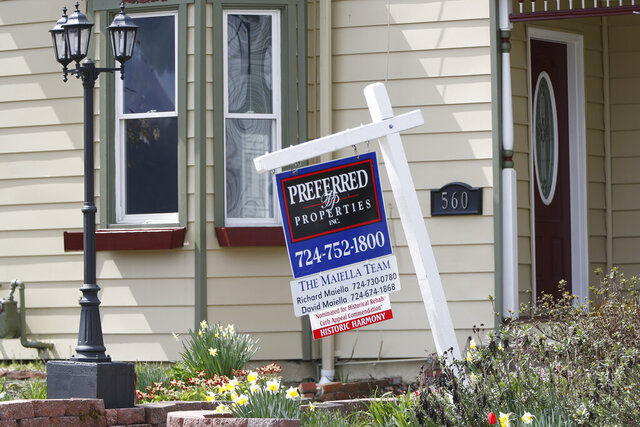 This April 16, 2020 photo shows a real estate company sign that marks a home for sale in Harmony, Pa. U.S. home sales showed signs of collapsing in March, as the number of contract signs plunged sharply because of the coronavirus outbreak. The National Association of Realtors said Wednesday, April 29,  that its pending home sales index, which measures signed buyer contracts, plummeted a seasonally adjusted 20.8% in March from the prior month to a reading of 88.2.  (AP Photo/Keith Srakocic, File)