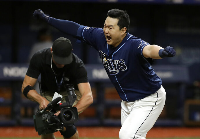 Tampa Bay Rays' Ji-Man Choi celebrates after his walkoff home run against New York Yankees relief pitcher Cory Gearrin during the 12th inning of a baseball game Tuesday, Sept. 24, 2019, in St. Petersburg, Fla. (AP Photo/Chris O'Meara)