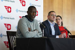 Dayton men's head coach Anthony Grant, left, speaks with the media, as Director of Athletics Neil Sullivan, center, and women's head coach Shauna Green look on Friday, March 13, 2020, in Dayton, Ohio. Both teams won their conferences, and the coaches said it was tough to see them lose what could be a once-in-a-lifetime chance for a national title, after the NCAA decision to cancel March Madness because of the coronavirus outbreak. (AP Photo/Aaron Doster)