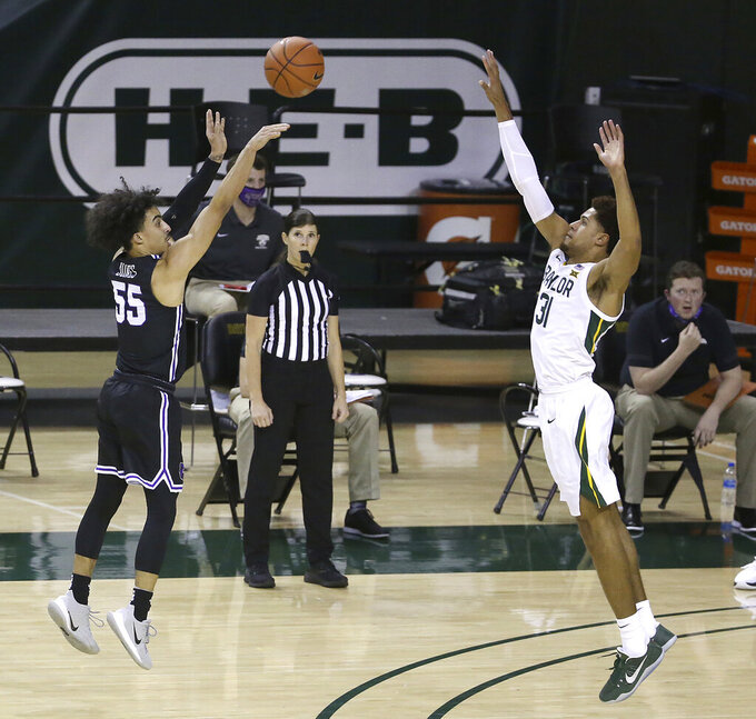 Central Arkansas guard DeAndre Jones (55) shoots a three point shot over Baylor guard MaCio Teague (31) in the second half of an NCAA college basketball game, Tuesday, Dec. 29, 2020, in Waco, Texas. (AP Photo/ Jerry Larson)
