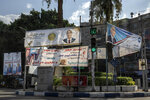 Election banners for candidates in the upper house of parliament are displayed on a street in Cairo, Egypt, Aug. 10, 2020. The elections will be held on Aug. 11 and 12. (AP Photo/Nariman El-Mofty)