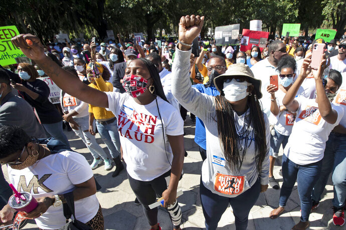"""REMOVES """"UNARMED"""" AND ADDS THAT AUTHORITIES HAVE NOT CONFIRMED THAT ARBERY WAS EITHER ARMED OR UNARMED - People react during a rally to protest the shooting of Ahmaud Arbery, Friday, May 8, 2020, in Brunswick Ga. Two men have been charged with murder in the February shooting death of Arbery,a black man in his mid-20s, whom they had pursued in a truck after spotting him running in their neighborhood. (AP Photo/John Bazemore)"""