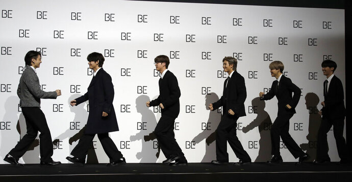 Members of South Korean K-pop band BTS arrive for a press conference to introduce their new album