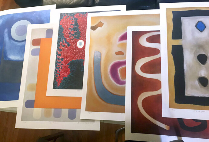 This photo provided by Michael Flaum shows some of the Benjamin Creme artwork that Los Angeles Police detectives have recovered in Los Angeles Tuesday, Nov. 5, 2019. The LAPD recovered $800,000 worth of prints by Scottish abstract expressionist Benjamin Creme after a caller told them they were in the person's home in the Los Angeles suburb of San Fernando. Police believe the 1,200 signed prints were there for several years but the caller who had them had only recently checked a law-enforcement database and discovered they were stolen. (Michael Flaum via AP)