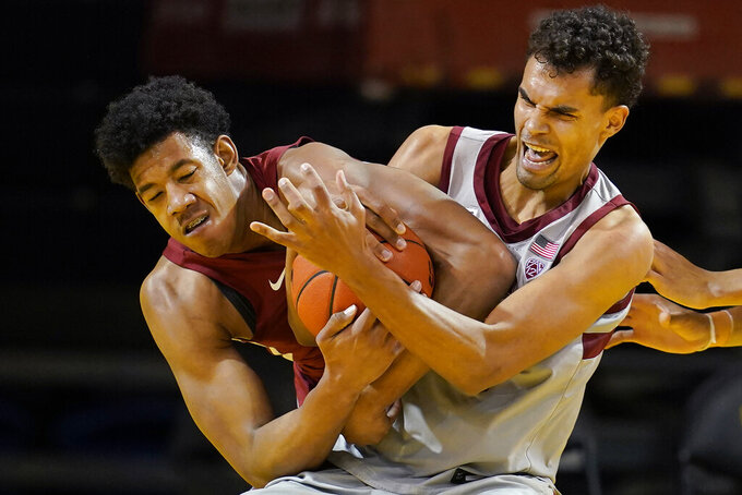 Washington State center Dishon Jackson, left, wrestles for the ball with Stanford forward Oscar da Silva during the second half of an NCAA college basketball game in Santa Cruz, Calif., Saturday, Jan. 9, 2021. (AP Photo/Jeff Chiu)