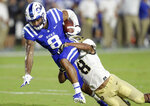 Duke's Aaron Young, left, is tackled by Army's Javhari Bourdeau following a pass reception during the first half of an NCAA college football game in Durham, N.C., Friday, Aug. 31, 2018. (AP Photo/Gerry Broome)