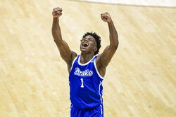 Drake's JosephYesufu celebrates late in the second half of a First Four game against Wichita State in the NCAA men's college basketball tournament Thursday, March 18, 2021, at Mackey Arena in West Lafayette, Ind. Drake won 53-52. (AP Photo/Robert Franklin)
