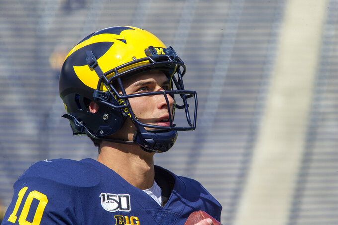 FILE - Michigan quarterback Dylan McCaffrey looks on during before an NCAA football game against Army in Ann Arbor, Mich., in this file photograph taken Saturday, Sept. 7, 2019. McCaffrey will be joining his father, retired NFL receiver Ed McCaffrey, to play at the University of Northern Colorado where his father is now the head coach of the football team. (AP Photo/Tony Ding, File)