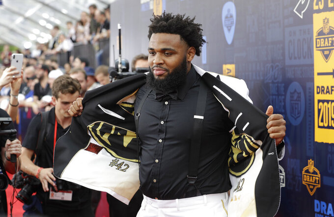 Clemson defensive tackle Christian Wilkins walks the red carpet ahead of the first round at the NFL football draft, Thursday, April 25, 2019, in Nashville, Tenn. (AP Photo/Steve Helber)