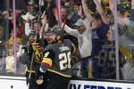 Vegas Golden Knights right wing Keegan Kolesar, center, celebrates after scoring against the Colorado Avalanche during the second period in Game 6 of an NHL hockey Stanley Cup second-round playoff series Thursday, June 10, 2021, in Las Vegas. (AP Photo/John Locher)