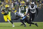 Green Bay Packers' Jamaal Williams runs for a first down during the second half of an NFL football game against the Carolina Panthers Sunday, Nov. 10, 2019, in Green Bay, Wis. (AP Photo/Jeffrey Phelps)