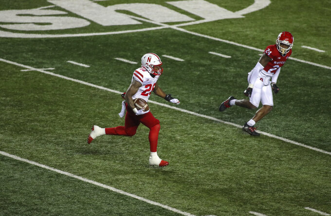 Nebraska running back Dedrick Mills (26) carries the ball for a 43-yard gain against Rutgers in the second quarter of an NCAA college football game Friday, Dec. 18, 2020, in Piscataway, N.J. (Andrew Mills/NJ Advance Media via AP)