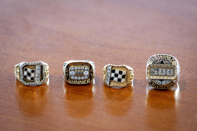 Rings of the only four-time winners of the Indianapolis 500 auto race sit on a table where the winner of this year's Indy 500, Helio Castroneves, gathered with other four-time winners A.J. Foyt (1961, 1964, 1967, 1977), Al Unser (1970, 1971, 1978, 1987) and Rick Mears (1979, 1984, 1988, 1991) at the Indianapolis Motor Speedway in Indianapolis, Tuesday, July 20, 2021. Castroneves won the race in 2001, 2002, 2009 and 2021. (AP Photo/Doug McSchooler)