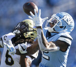 Wake Forest defense back Ja'Sir Taylor (6) defends North Carolina's Dyami Brown (2) in the first half of an NCAA college football game Saturday, Nov. 14, 2020, in Chapel Hill, N.C. Taylor intercepted the pass. (Robert Willett/The News & Observer via AP, Pool)
