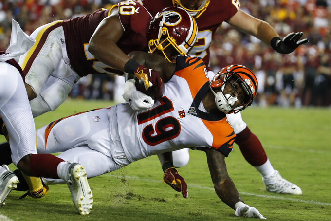 Washington Redskins linebacker Josh Harvey-Clemons (40) tackles Cincinnati Bengals wide receiver Auden Tate (19) during the first half of an NFL preseason football game Thursday, Aug. 15, 2019, in Landover, Md. (AP Photo/Alex Brandon)