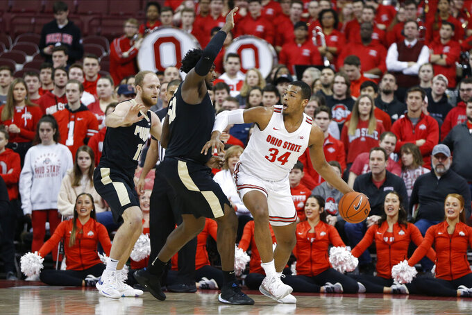 Ohio State's Kaleb Wesson, right, posts up against Purdue's Trevion Williams during the first half of an NCAA college basketball game Saturday, Feb. 15, 2020, in Columbus, Ohio. Ohio State beat Purdue 68-52. (AP Photo/Jay LaPrete)
