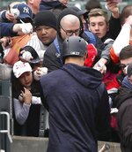 Fans wait as New York Yankees right fielder Giancarlo Stanton gives autographs before a baseball game against the Detroit Tigers, Friday, April 13, 2018, in Detroit. (AP Photo/Carlos Osorio)
