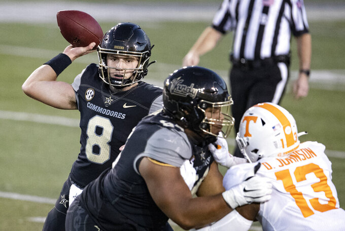 Vanderbilt quarterback Ken Seals (8) throws to a receiver during the second half of an NCAA college football game against Tennessee, Saturday, Dec. 12, 2020, in Nashville, Tenn. (AP Photo/Wade Payne)