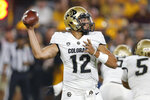 Colorado quarterback Steven Montez (12) throws a pass against Arizona State during the first half of an NCAA college football game Saturday, Sept. 21, 2019, in Tempe, Ariz. (AP Photo/Rick Scuteri)