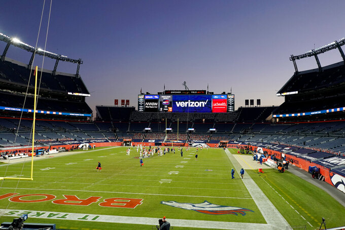 The Denver Broncos and the New Orleans Saints meet at mid field after an NFL football game, Sunday, Nov. 29, 2020, in Denver. The Saints won 31-3. (AP Photo/Jack Dempsey)