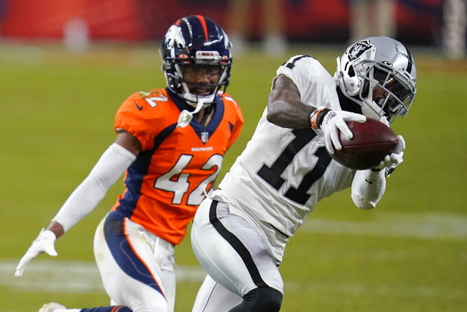 Las Vegas Raiders wide receiver Henry Ruggs III (11) makes a catch against Denver Broncos cornerback Parnell Motley during the second half of an NFL football game, Sunday, Jan. 3, 2021, in Denver. (AP Photo/David Zalubowski)