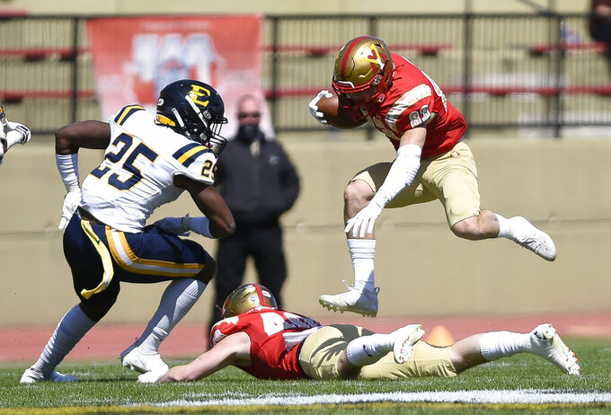 VMI Chance Knox (83) leaps over teammate Grant Swinehart (40) while EEast Tennessee State's D'Andre Davis (25) reacts during the first half of an NCAA college football game Saturday, April 3, 2021, in Lexington, Va. (David Hungate/The Roanoke Times via AP)