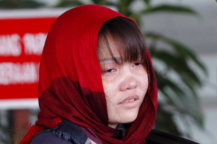 Vietnamese Doan Thi Huong is escorted by police as she leaves Shah Alam High Court in Shah Alam, Malaysia, Thursday, March 14, 2019. Malaysia's attorney general ordered the murder case to proceed against the Vietnamese woman accused in the killing of the North Korean leader's estranged half brother, prosecutors said in court Thursday. (AP Photo/Vincent Thian)
