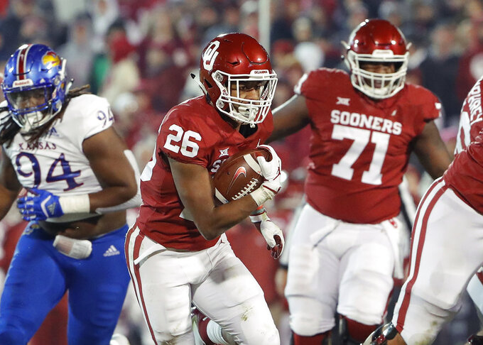 Oklahoma running back Kennedy Brooks (26) runs against Kansas during the second half of an NCAA college football game in Norman, Okla., Saturday, Nov. 17, 2018. Oklahoma won 55-40. (AP Photo/Alonzo Adams)