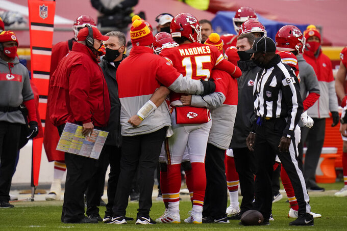 Kansas City Chiefs quarterback Patrick Mahomes (15) is helped off the field after getting injured during the second half of an NFL divisional round football game against the Cleveland Browns, Sunday, Jan. 17, 2021, in Kansas City. (AP Photo/Jeff Roberson)