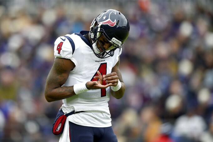 Houston Texans quarterback Deshaun Watson inspects his hand after a play against the Baltimore Ravens during the first half of an NFL football game, Sunday, Nov. 17, 2019, in Baltimore. (AP Photo/Gail Burton)