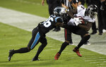 Atlanta Falcons wide receiver Christian Blakeis tackled by Carolina Panthers cornerback Donte Jackson during the first half of an NFL football game Thursday, Oct. 29, 2020, in Charlotte, N.C. (AP Photo/Mike McCarn)