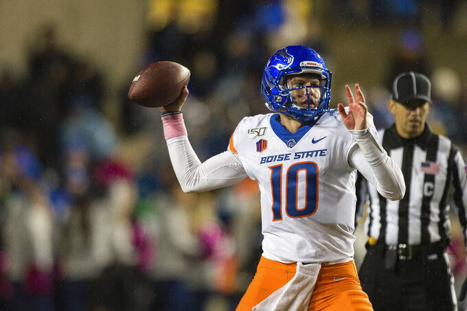 Boise State quarterback Chase Cord (10) throws a pass during the first half of the team's NCAA college football game against BYU on Saturday, Oct. 19, 2019, in Provo, Utah. (AP Photo/Tyler Tate)